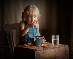A Big Bite (Sonya Adcock Photography) Tags: girl child kid photography childphotography light evening glow warm family painterly portrait ray poetry poetic story nikon nikond700 nikkor nikkor105mmdc childhood fineart fineartphotography art sonyaadcockphotography