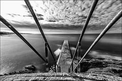 Encore quelques marches.../ Some steps more... (vedebe) Tags: netb noiretblanc nb bw monochrome escaliers ocean océan mer eau pontons jetée ciel nuages poselongue port ports bretagne