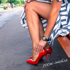 A woman feels pain in her legs (zoom_machine) Tags: female pain leg fatigue highheel shoes health veins phlebology care woman red dress discomfort girl