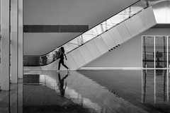on the run / all the leading lines (Özgür Gürgey) Tags: 2018 50mm bw bodrum d750 nikon pinkfloyd airport architecture escalator lines people reflection running
