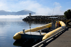 Morning at The Dock (Anthony Mark Images) Tags: inflatableboat boat yellowinflatable fog morning water sea ocean reflections dock mountains rocks pier barnacles sitka alaska usa 49thstate nikon d850 seascape