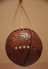 Carved coconut shell purchased on Reunion Island (Sokleine) Tags: coconut noixdecoco écorce tan sculpture artisanat craft handcraft reunionisland réunion souvenir objet object suspension france outremer