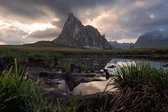 Ra Gusela (Daniele Bisognin) Tags: clouds grass italy lake mirror peak sunset unesco water dolomites dolomiti mountains passogiau reflect sky