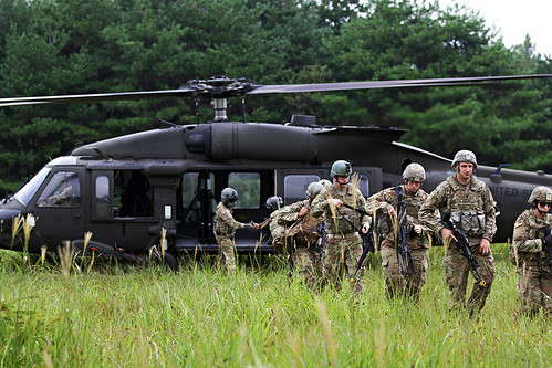 Indiana National Guardsmen exit a UH-60 after a bilateral flight during Orient Shield 2018