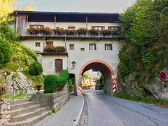 House with a road through it in Oberaudorf, Bavaria, Germany (UweBKK (α 77 on )) Tags: house building architecture road rock stone tunnel arch special oberaudorf bayern bavaria germany deutschland europe europa iphone balcony flowers
