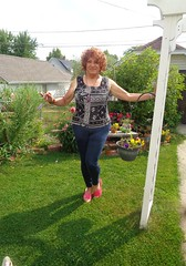 Big Girl In A Small Yard (Laurette Victoria) Tags: garden leggings redhead curly woman laurette milwaukee
