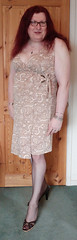 Multi patterned dress standing1 (dianne66uk) Tags: transwoman heels hosiery redhair glasses