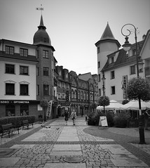 Streets of Lebork (roomman) Tags: 2018 poland baltic sea coast north bw black white bandw contrast grey scale monochrome design sharp crisp lebork lębork town city shop shops shopping