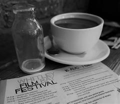 24 Aug - Rainbird (Mr Ian Lamb 2) Tags: listing coffeecup milkbottle filmfestival whitleybay jamjarcinema monochrome bandw spoon saucer programme program glass objects printed word mono focus victornoblerainbird
