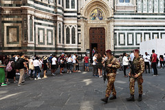 Camouflage (airSnapshooter) Tags: soldier firenze italy weapon uniform door wall cathedral squares boots architecture outdoor