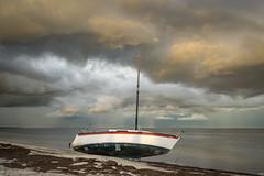 Grounded (D~P~B) Tags: florida st petersburg saintpetersburg grounded storm clouds nikon sailboat