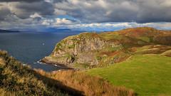 Isle of Seil (Noel Wyn Davies) Tags: scotland argyll seil oban ellenabeich mull firthoflorn sea highlands mountains coast boat yacht rocks sunshine shower grass hill summer