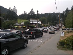 Bowen Island Lineup BC18h25 LG (CanadaGood) Tags: canada bc britishcolumbia bowenisland tree building sign people person shore canadagood 2018 thisdecade color colour cameraphone powerlines