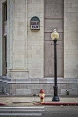Stained Glass Robbery Alarm (Mike Schaffner) Tags: alarm building crosswalk firehydrant lamppost robberyalarm stainedglass pawhuska oklahoma unitedstates us