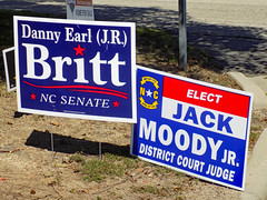 Political Signs. (dccradio) Tags: lumberton nc northcarolina robesoncounty outdoor outdoors outside sign signs nikon coolpix l340 bridgecamera september wednesday morning goodmorning latesummer earlyautumn earlyfall politicalsigns election elect britt moody districtcourtjudge ncsenate senate lawn grass greenery sand dirt pavement curb paved street