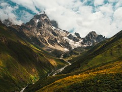 Valley (Valentin_Efimov) Tags: mountain mountains peak summit top valley snow river summer sky cloud clouds green hill hills landscape grass field mountainside