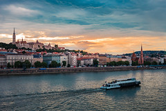 Cold sunset view from Bridge in Budapest, castle, river, and boat (T is for traveler) Tags: summer old european tower scenic capital famous church landmark budapest travel blue castle city water river sea skyline architecture view night sky cityscape panorama boat sunset building ship landscape europe urban bridge town tourism harbor hungary buda danube traveler traveling tisfortraveler travelphotography backpacker digitalnomad canon 5d markii yongnuo 50mm