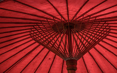 Details of a Thai traditional red umbrella (phuong.sg@gmail.com) Tags: asia asian background colorful crafts culture decoration decorative design detail east element exotic fabric glamor hand handcraft japan japanese made myanmar objects orange oriental ornament paper paperwork parasols pattern red ricepaper shade spiral sticks summer sunny sunshade textile texture thailand traditional traditions travel umbrella wood