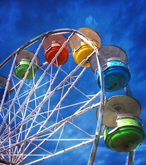 Wheel in the Sky (yerica38) Tags: themeparkride park amusement amusementpark fair windosr windsorfair windsormaine countyfair fun vintage texture wheel ferriswheel round circle high dramaticsky sky seat colorful