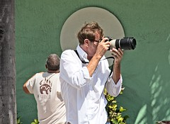 White Shirted photographer  104 (LarryJay99 ) Tags: pridefest2018 2018 lakeworth florida festival parade photographer men male man guy guys dude dudes canondslr canoncanon handsome handsomenen hairyarms streets streetstuff urbanimpressions urbannomads urbanites people gaypeople urban container script potted plant street furniture los olas ft lauderdale