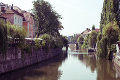Ljubljana and its river (Blacklili) Tags: ljubljana slovenia slovenija boat city houses river trees water sky landscape capital