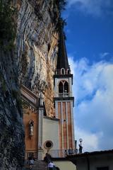 In un incavo scavato nel monte Baldo sorge il  Santuario della Madonna della Corona (ornella sartore) Tags: roccia cielo santuario nuvole allaperto colori particolari