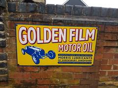 Golden Film motor oil sign (DorsetBelle) Tags: morrislubricants eppingongarrailway vitreousenamelsigns enamelsigns advertisingsigns railwaysigns goldenfilmmotoroil ongarstation