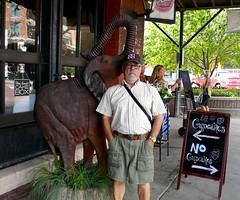 Ali by elephant sculpture, Old Market, Omaha (ali eminov) Tags: omaha nebraska oldmarket signs ali