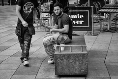 Once round the block (Nikonsnapper) Tags: leica m10 summicron 90mm candid man sitting concrete block walking street bw