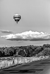 Black and White Balloon (Missy Jussy) Tags: france hotairballoon clouds forest woodland trees road fence landscape land mono monochrome blackwhite views bw blackandwhite 70200mm ef70200mmf4lusm ef70200mm canon70200mm 5d canon5dmarkll canon5d canoneos5dmarkii canon beynacetcazenac