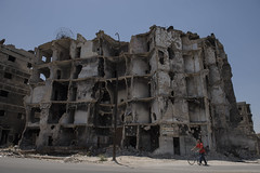 SOD_9047 (Hasan Blal) Tags: old damaged war syria aleppo crisis isis army building bicycle man