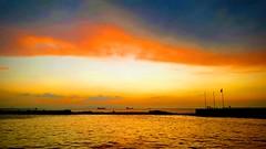 And sun kiss the sea (simaykosal) Tags: sunset sea red yellow blue sky love greece greek island mykonos izmir