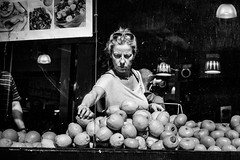 Firm (Kieron Ellis) Tags: woman shopping lemons oranges fruit window dirty sunglasses street candid blackandwhite blackwhite monochrome bright dark contrast