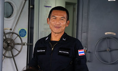Reassuring smile of Marine Officer จักรชัย  ลิ้มธาราดล (B℮n) Tags: เกาะราชาใหญ่ racha island raya paradise divers korachayai kohrachayai crystal clear waters white sand beach palmtrees speedboat warm coconuts buffalo asian tropical thailand vacation snorkeling season pathways relax getaway swimming strand bounty resort rayaresort andaman sea wonderful small beaches snorkling palmtree longtailboat secluded thunderstorm storm stormy weather rainy thai police marine boat resque stranded strong wind highwaves tourist stucked saved department marinepolice royalthai safe news phuket chakachailimtharadhon จักรชัยลิ้มธาราดล portrait portret face smile smiling reassuring 50faves topf50