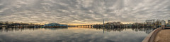 The sunset panorama of the West Spit of Yelagin Island. (g_reg_walker) Tags: travel excursion sights sightseeing stroll tourism tourist trip walk season spring saint petersburg russia park yelagin island city perspective view cityscape spit landscape scenery light panorama river neva sky dark grey cloudy water reflection sunset evening west parapet bank shore