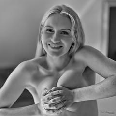 Squeezing can be fun ... (piotr_szymanek) Tags: ola olao blackandwhite studio woman young skinny face eyesoncamera freckles portrait smile blonde longhair 1k 20f 50f 100f 5k 10k