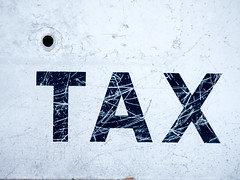 TAX (joncutrer) Tags: sign tax weathered bright signage vintage taxes scratched worn grunge