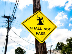 Shall Not Pass (photographyguy) Tags: shreveport louisiana unitedstates us roadsign cellphonephotography funny sign powerpole lordoftherings sky clouds downtownshreveport