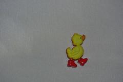 Little yellow duck (Dreaming of the Sea) Tags: smileonsaturday nikon tamronsp90mmf2811macro nikond7200 dusk miniinminimalism whitebackground redboots yellowduck