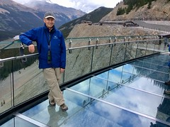 Yours truly on Canada's Glacier Skywalk above  Sunwapta Valley (lhboudreau) Tags: skywalk mountainside forest mountain tree trees sky wood landscape glacierskywalk canada alberta walkway glasswalkway glassfloored sunwaptavalley sunwapta discoverytrail trail cliffedge cliff people outdoor outdoors canadianrockies mountains rockymountains glass reflection