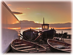 Early morning light, Moville, Co. Donegal. (willieguildea) Tags: sun sunrise sky clouds dawn reflections boat boats fishingboats moville donegal ireland eire ulster nikon foyle loughfoyle coolpix p900 water river