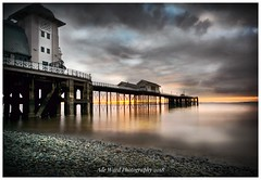 Darkness turns to Light (awardphotography73) Tags: cymru cardiff gloomy sunrise morning clouds seafront pebbles coast southwales wales penarthpier pier penarth