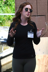 Meg Explaining The Salmon Hatchery (Anthony Mark Images) Tags: people portrait female redhead redhair sunglasses prettygirl cute freckles oliveleggings blackshirt fishhatchery salmonhatchery teaching tourguide salmon sitka alaska usa 49thstate