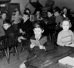 Look I can read (theirhistory) Tags: boy children kid girl school class form pupils trousers jumper shoes wellies boots book