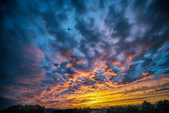 Sunset in Amsterdam Zuidoost (Merlijn Hoek) Tags: sunset amsterdam amsterdamzuidoost zuidoost merlijnhoek clouds sky wolken epic plane vliegtuig landing schiphol