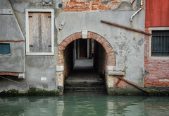 A Canal Passage (henriksundholm.com) Tags: architecture building canal flooded reflections ripples daylight tunnel passage steps brick facade shadows dark venice italy