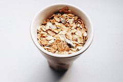 Top view of muesli in a cup. Close up (wuestenigel) Tags: glass dry natural sweet breakfast table muesli background snack diet morning food sweets health meal flakes white cup bowl closeup isolated red fruit yogurt grain wooden healthy texture jar raisin milk yoghurt orange seed fruits yellow vegetables organic