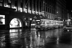 Helsinki tram (Chilanga Cement) Tags: fuji fujix100f fujifilm bw blackandwhite monochrome helsinki finland night reflections reflecting reflection reflective waterreflection rain