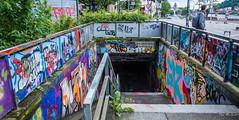 2018 - Germany - Heidelberg - S-Bahn Altstadt (Ted's photos - For Me & You) Tags: 2018 cropped germany heidelberg nikon nikond750 nikonfx tedmcgrath tedsphotos vignetting heidelberggermany steps stairs graffiti backpack streetscene street river neckarriver bridge colorful colourful willokay you miami okay we people that from h railing