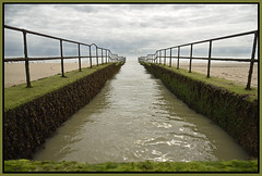 looking out to sea (Wrightview (formerly pabcorr)) Tags: coast rural seafront sea dymchurch railings clouds inlet outlet sand beach seaweed
